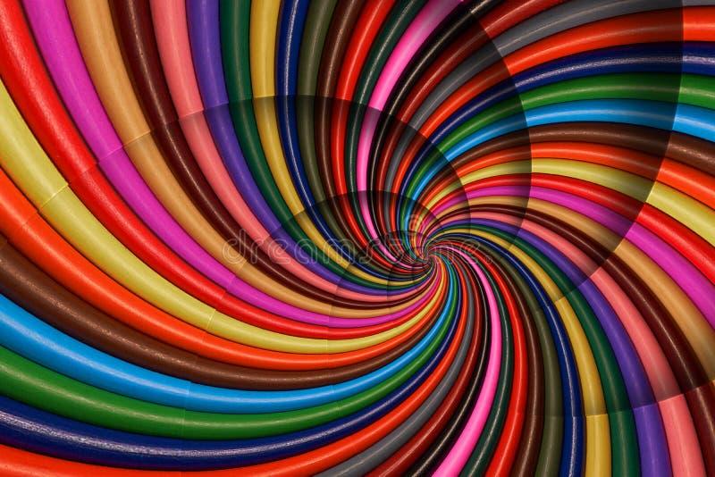 Den färgrika regnbågen vässar blyertspennor röra sig i spiral bakgrundsmodellfractal Blyertspennabakgrundsmodell Spiral fr för ab royaltyfri illustrationer