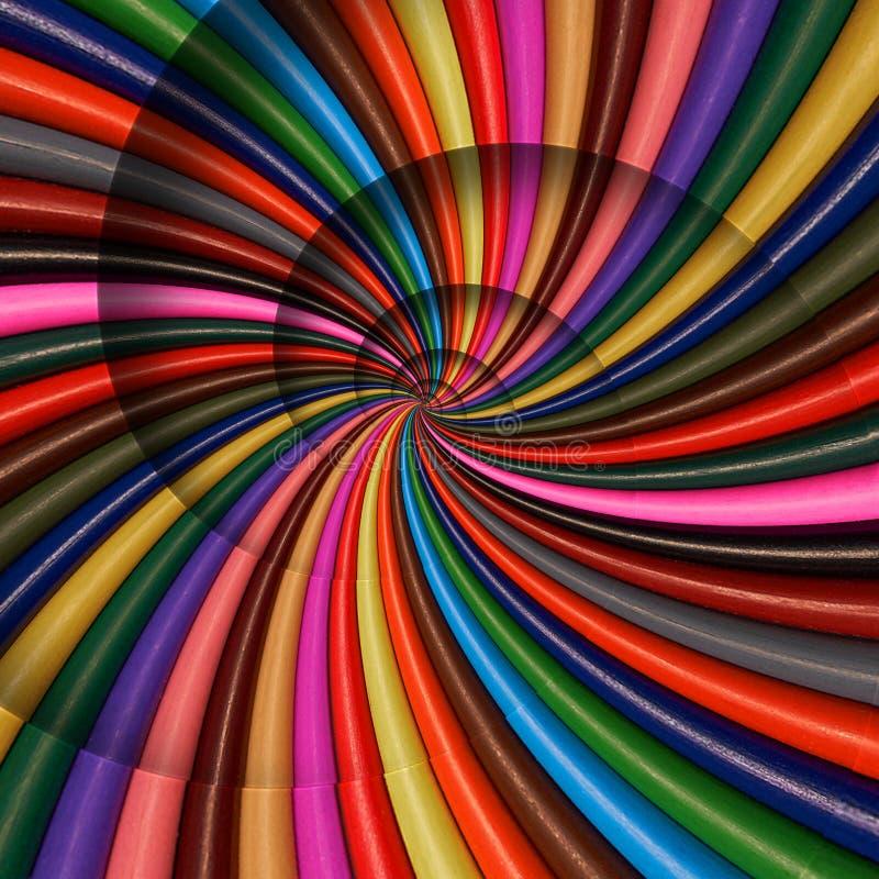 Den färgrika regnbågen vässar blyertspennor röra sig i spiral bakgrundsmodellfractal Blyertspennabakgrundsmodell Frac för spiral  royaltyfri fotografi