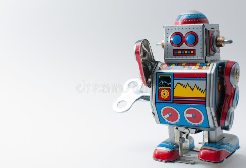 Den färgrika roboten med mekaniskt spolar upp tangent royaltyfria bilder