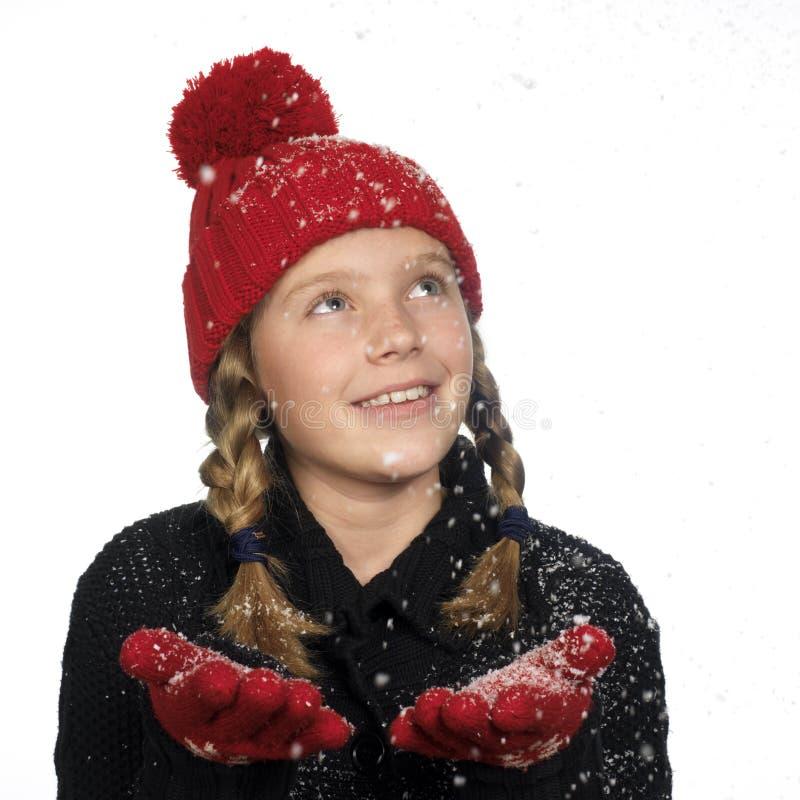 den fångande flakesflickan hand henne snow royaltyfri foto