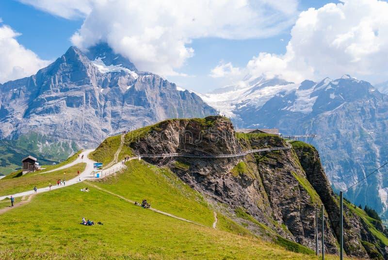 Den första himmelklippan går Grindelwald Bern, Schweiz fotografering för bildbyråer