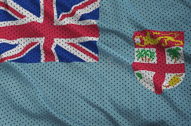 Den fijianska flaggan skrivev ut på wi för ett tyg för ingrepp för polyesternylonsportswear arkivfoto