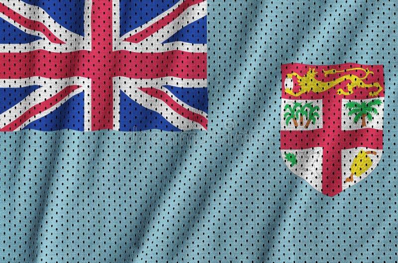Den fijianska flaggan skrivev ut på wi för ett tyg för ingrepp för polyesternylonsportswear royaltyfria foton