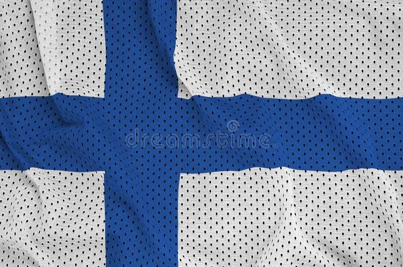 Den Finland flaggan skrivev ut på ett tyg för ingrepp för polyesternylonsportswear royaltyfri fotografi