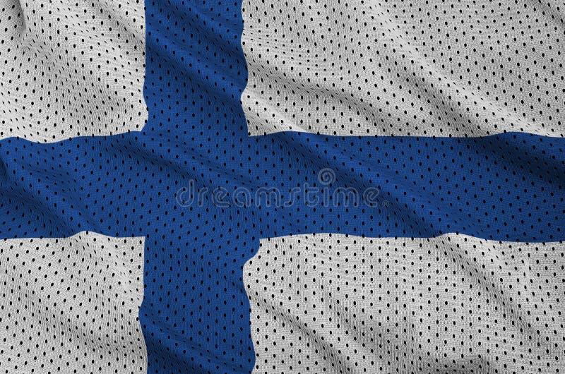 Den Finland flaggan skrivev ut på ett tyg för ingrepp för polyesternylonsportswear fotografering för bildbyråer
