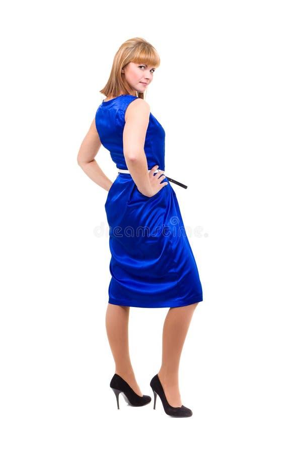 Den fulla längden av den sinnliga kvinnan i blått klär arkivfoton