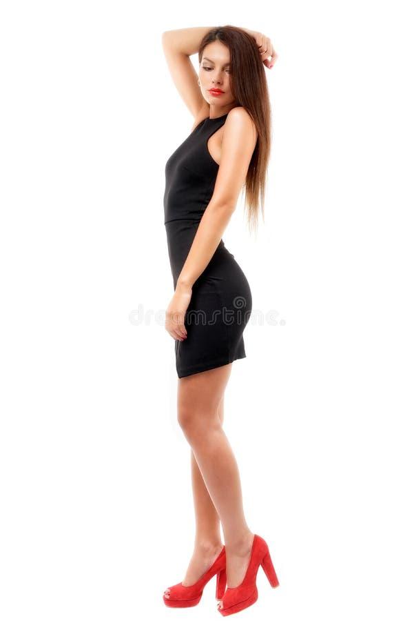 Den fulla längden sköt av sexig kvinna i aftonklänning, isolerat på whi arkivbilder