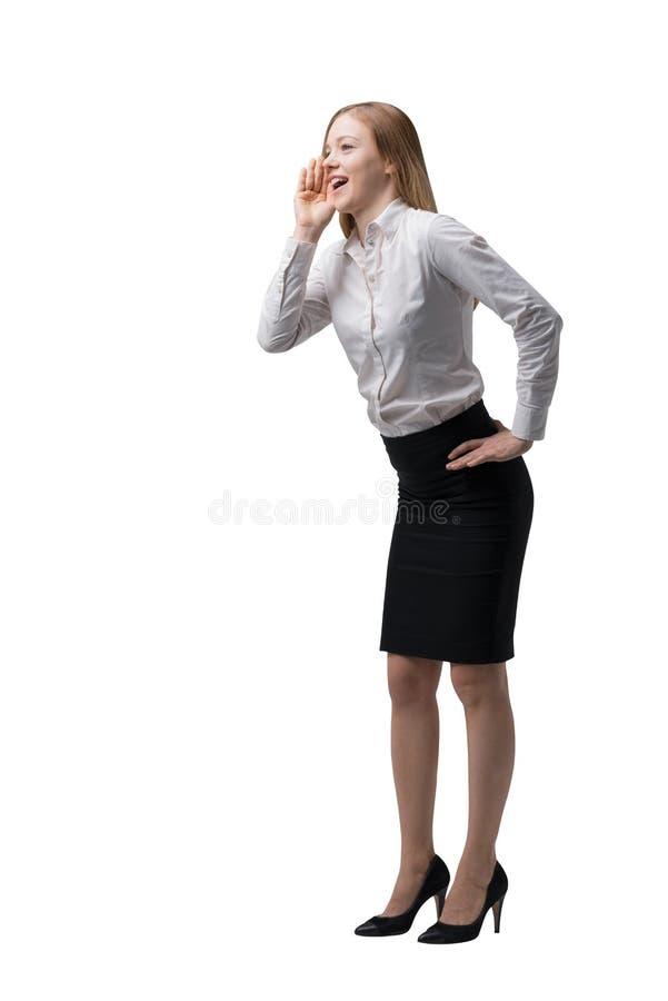 Den fulla längdsidosikten av affärsdamen i formell kläder försöker att dra uppmärksamheten till något isolerat arkivbild