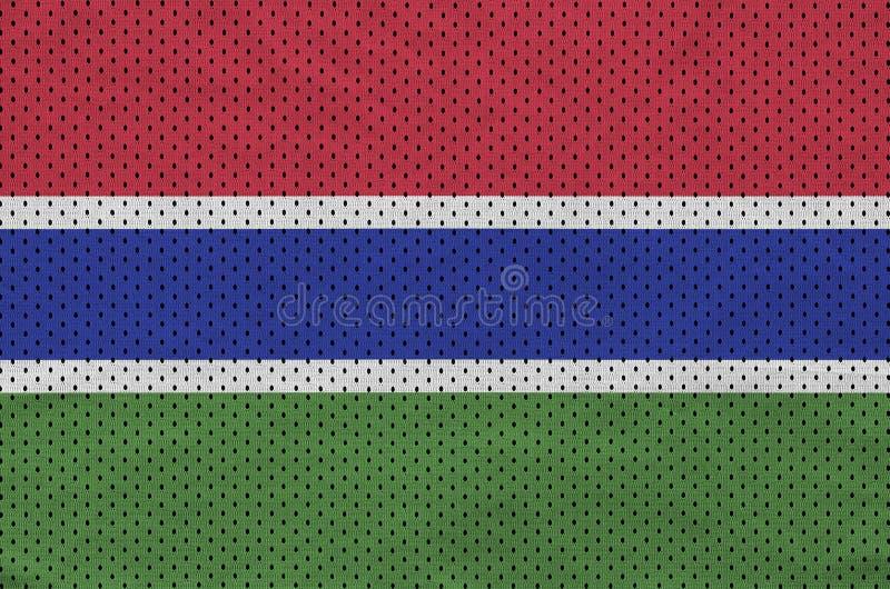 Den Gambia flaggan skrivev ut på ett tyg för ingrepp för polyesternylonsportswear royaltyfri fotografi