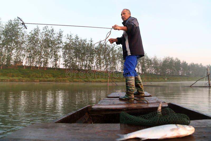 Den gamla fiskaren royaltyfri foto
