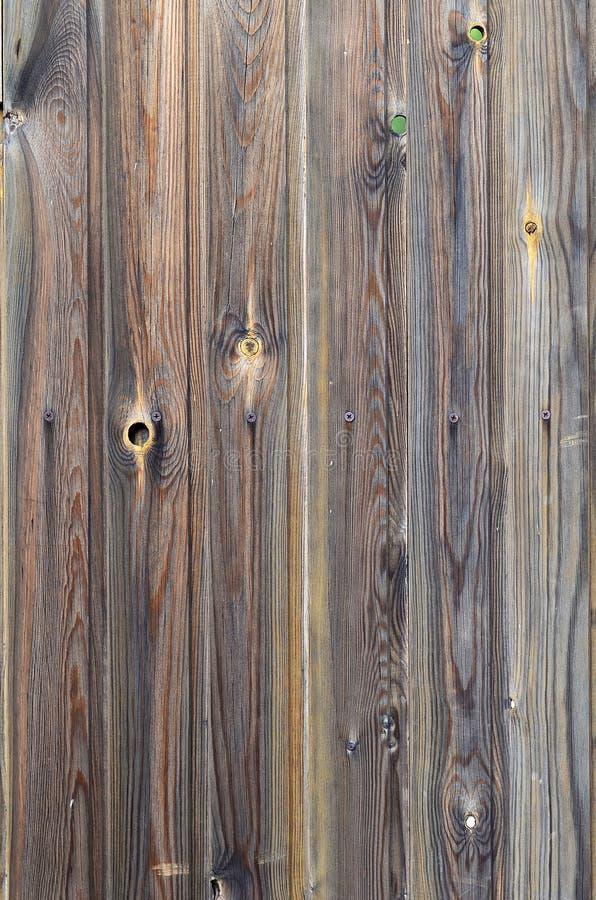 Den gamla modellen för panelen för mörk brunt för grunge wood med härlig abstrakt kornyttersidatextur, lodlinje gjorde randig bak royaltyfria bilder