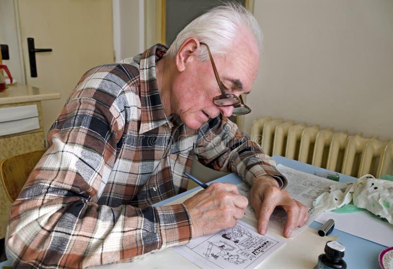 Den gamla skämttecknaren arkivfoto