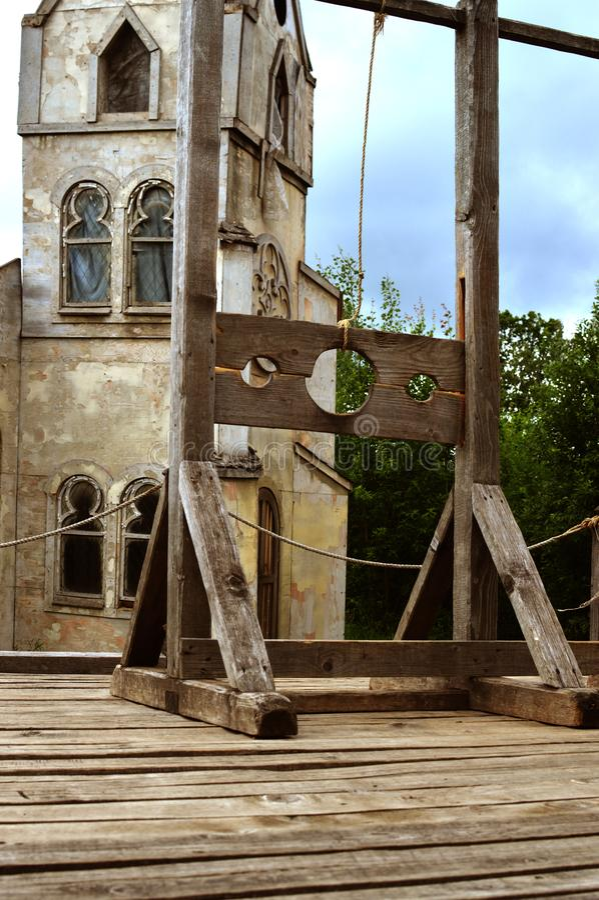 Den gamla träapparaten för tortyr royaltyfri foto