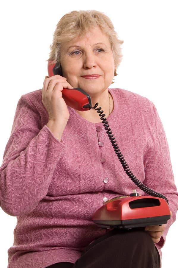 den gammalare telefonen talar kvinnan arkivbild