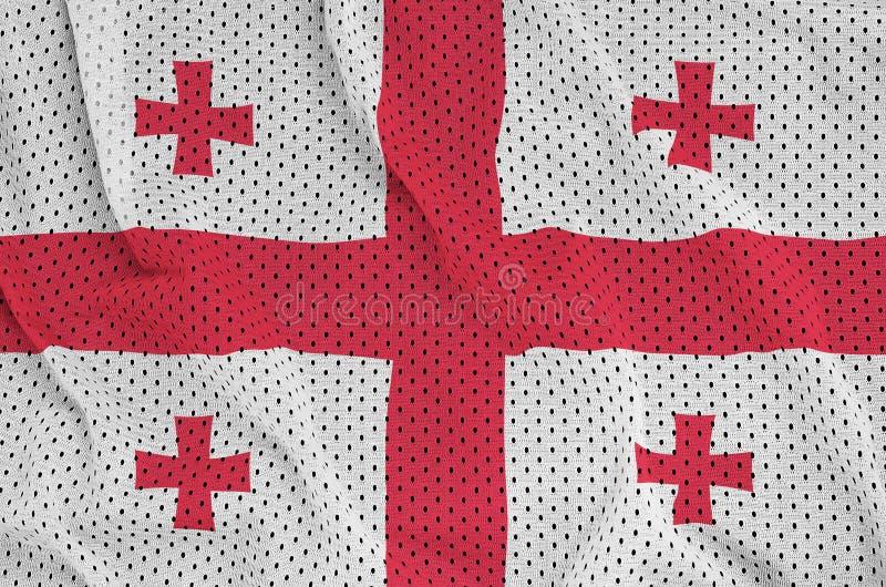 Den Georgia flaggan skrivev ut på ett tyg för ingrepp för polyesternylonsportswear royaltyfri foto