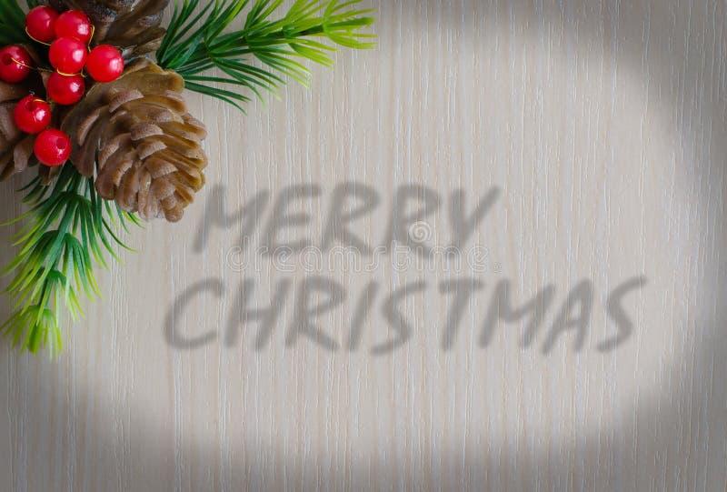 Den glade julen f?r inskrift Bakgrund - tr?textur royaltyfri foto