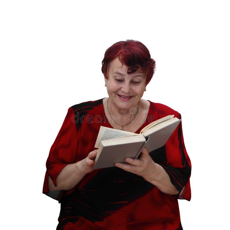 Download Den Gladlynta Höga Kvinnan Läser Boken Arkivfoto - Bild av äldre, alon: 78730940