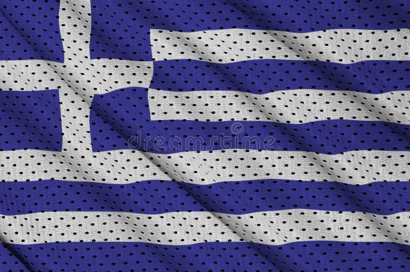 Den Grekland flaggan skrivev ut på ett tyg för ingrepp för polyesternylonsportswear royaltyfria bilder