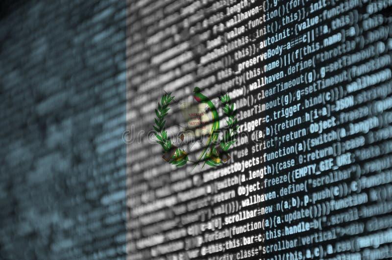 Den Guatemala flaggan visas på skärmen med programkoden Begreppet av modern teknologi- och platsutveckling royaltyfri fotografi