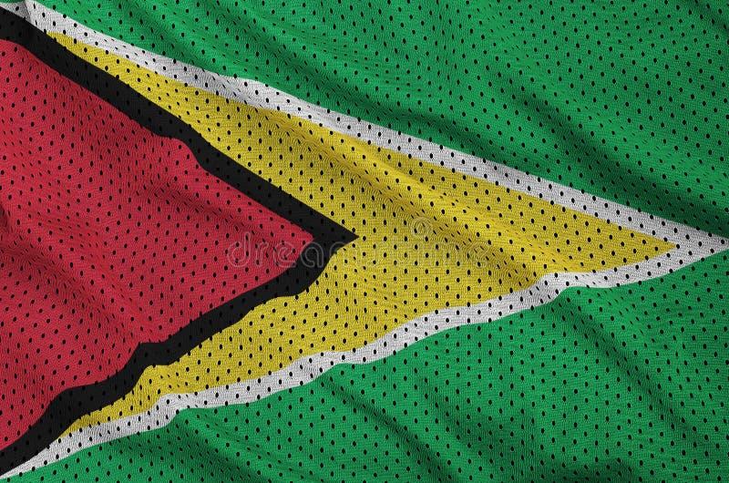 Den Guyana flaggan skrivev ut på ett tyg för ingrepp för polyesternylonsportswear arkivbild