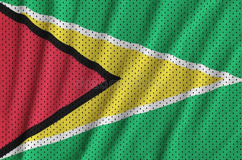Den Guyana flaggan skrivev ut på ett tyg för ingrepp för polyesternylonsportswear arkivbilder