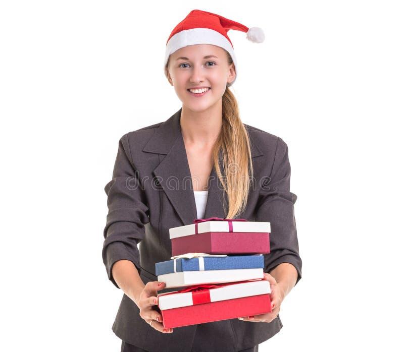 Den härliga caucasian affärskvinnan i grå färger passar och att bära röd chri royaltyfri bild