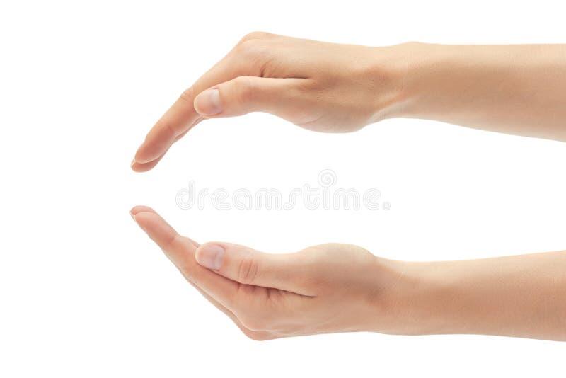 Den härliga kvinnliga handen skyddar gest bakgrund isolerad white arkivbilder