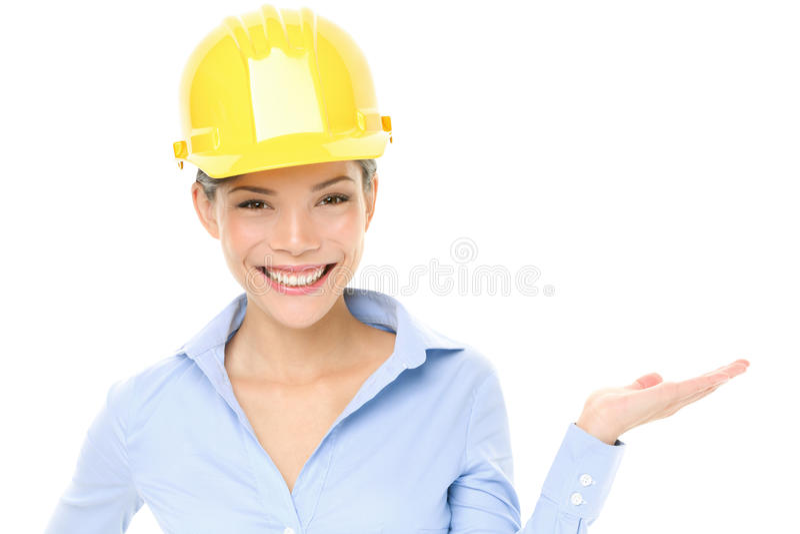 Den hårda hatten iscensätter eller arkitektkvinnavisningen royaltyfri bild