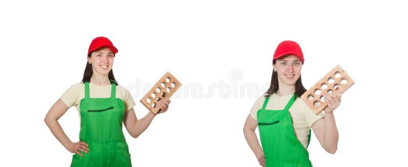 Den h?llande lerategelstenen f?r kvinna som isoleras p? vit arkivfoton