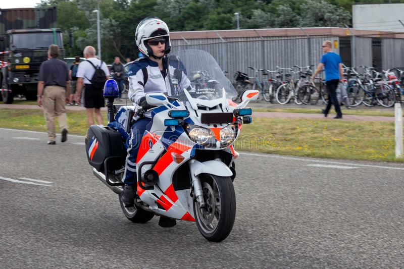 Dutch military police Marechaussee motorbike. DEN HELDER, NETHERLANDS - JUl 7, 2012: Dutch military police (Marechaussee) officers patrolling on his motorbike in royalty free stock photo