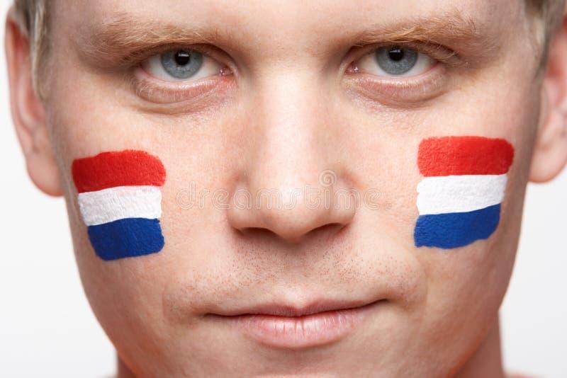 den holländska manlign för f-ventilatorflaggan målade sportar unga royaltyfri fotografi