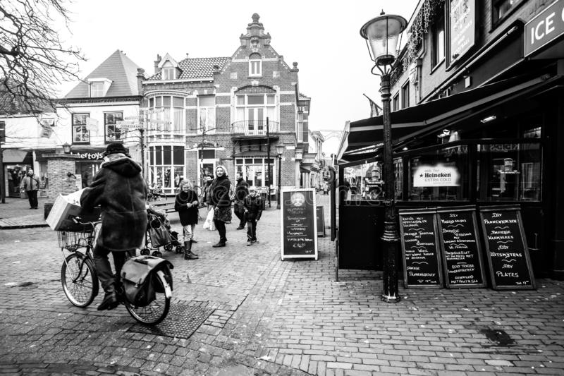 Den Hoorn, The Netherlands - February 25, 2010: People walking along the street in the the small town Den Hoorn on Texel island royalty free stock images