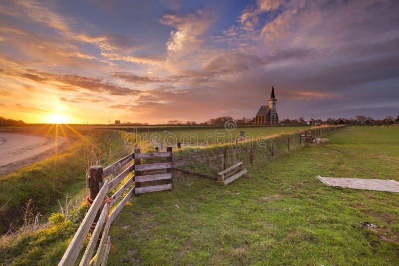 Den Hoorn on Texel island in The Netherlands. The church of Den Hoorn on the island of Texel in The Netherlands at sunrise stock photos