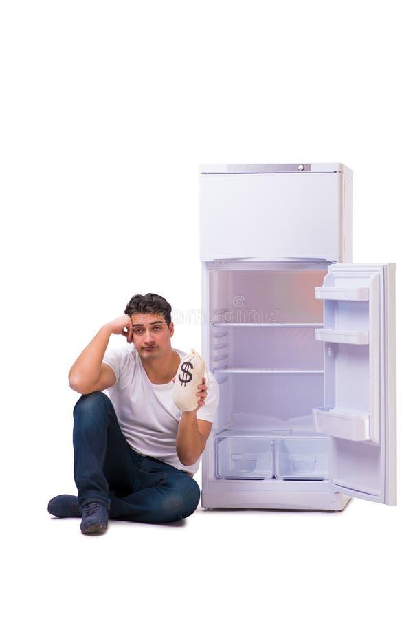 Den hungriga mannen som söker efter pengar för att fylla kylen royaltyfria foton