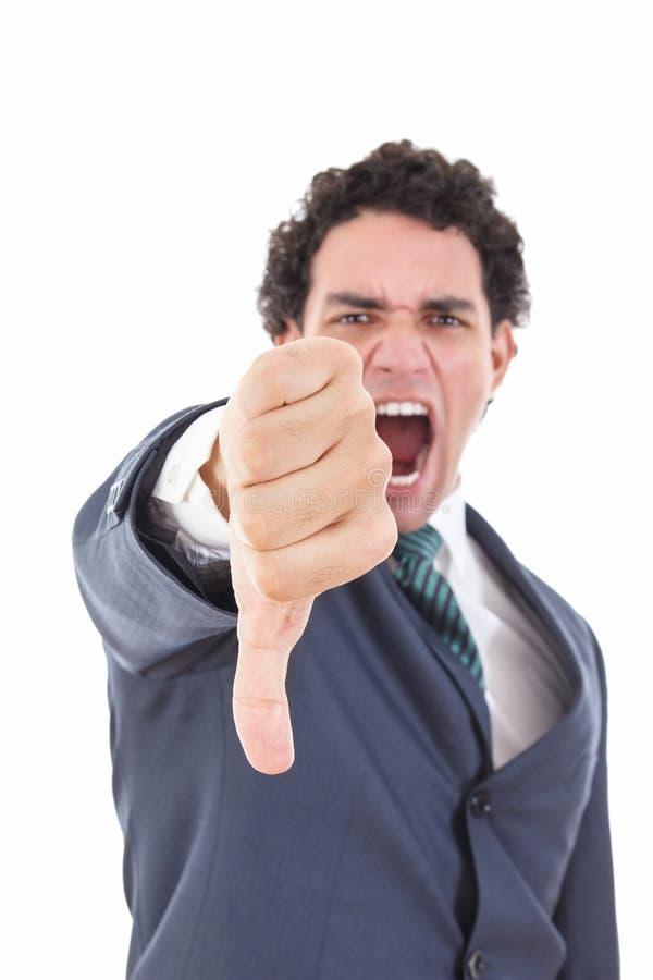 Den ilskna affärsmanvisningtummen gör en gest ner som kasseringssymbol arkivfoton