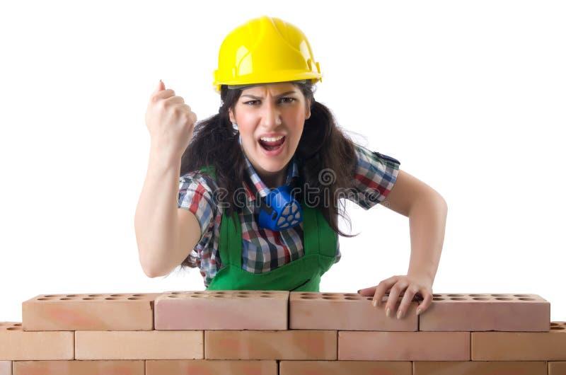 Den ilskna kvinnliga byggnadsarbetaren på vit fotografering för bildbyråer