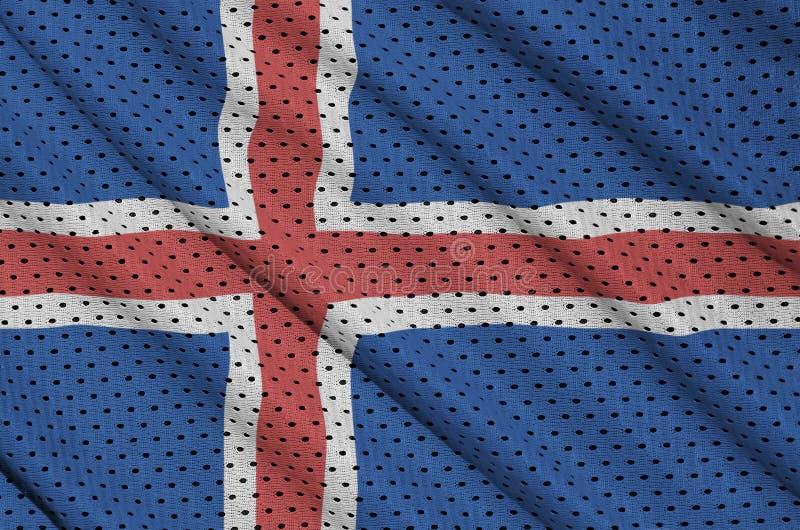 Den Island flaggan skrivev ut på ett tyg för ingrepp för polyesternylonsportswear arkivfoto