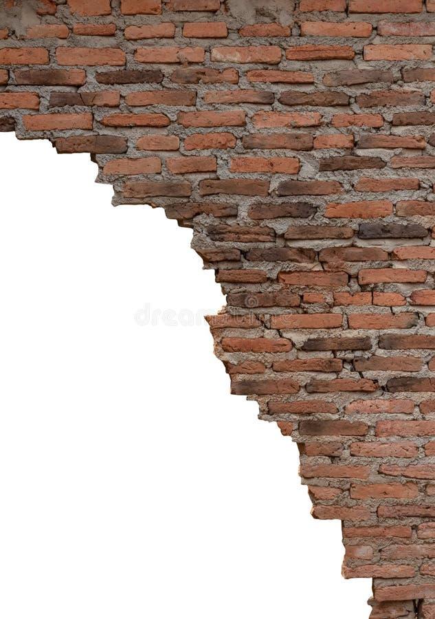 Den isolerade gamla tegelstenväggen är bruten arkivbild