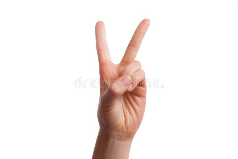 Den isolerade handen visar numret två Begrepp för nummer två arkivbilder