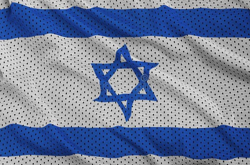 Den Israel flaggan skrivev ut på ett tyg för ingrepp för polyesternylonsportswear arkivfoto