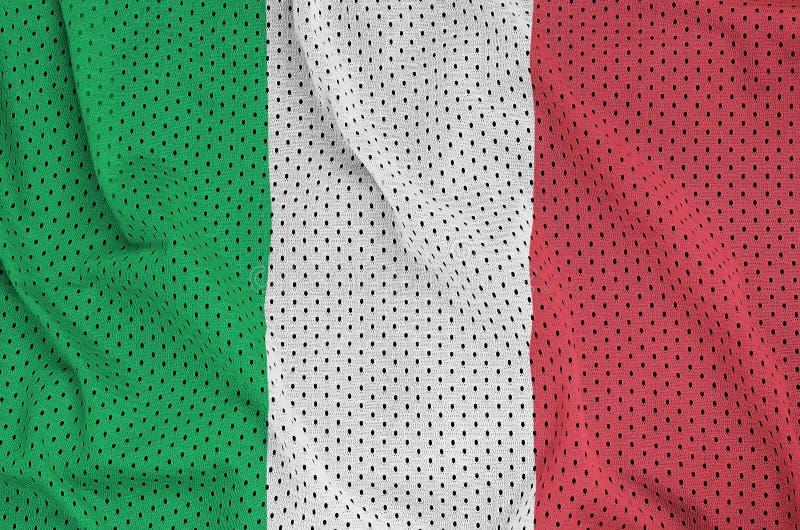 Den Italien flaggan skrivev ut på ett tyg för ingrepp för polyesternylonsportswear w royaltyfri fotografi