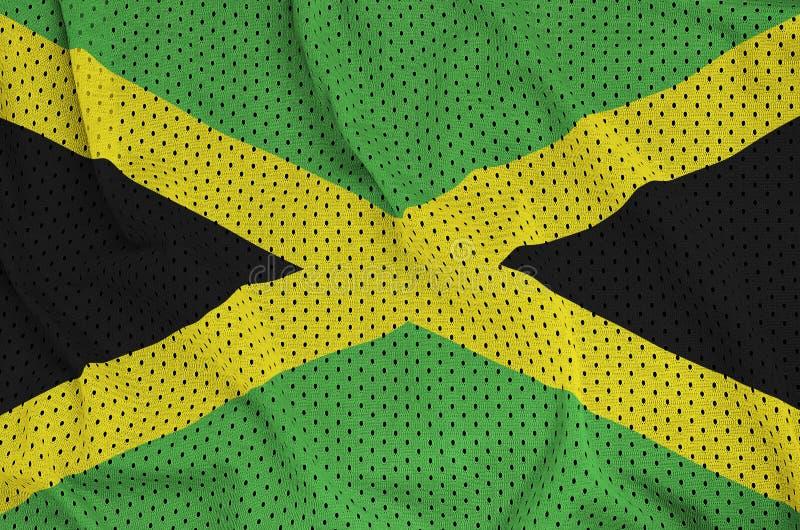 Den Jamaica flaggan skrivev ut på ett tyg för ingrepp för polyesternylonsportswear arkivbilder