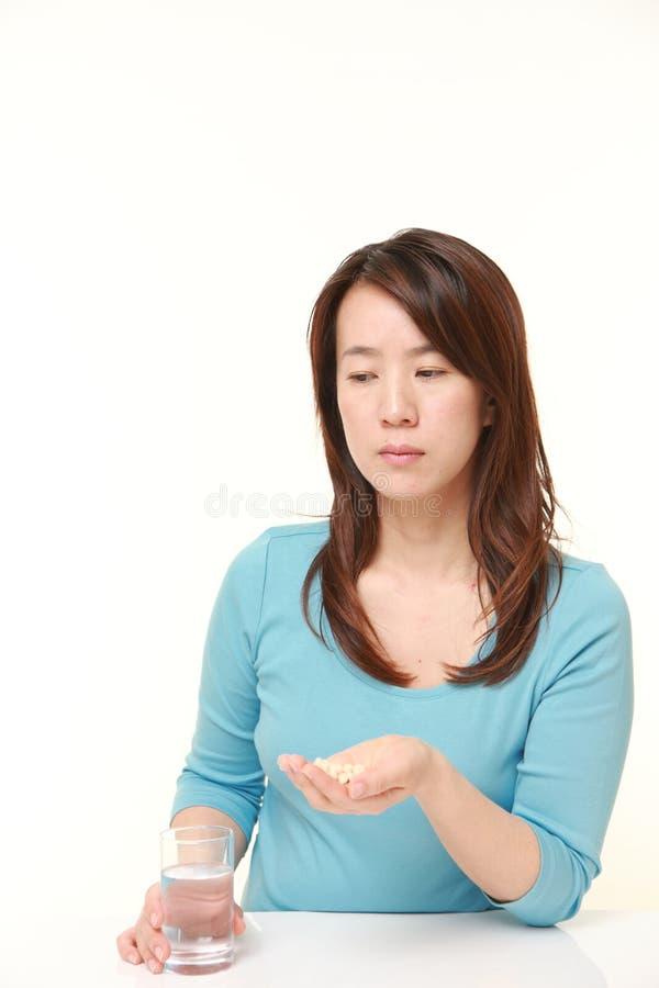 Den japanska kvinnan lider från melankoliskt arkivfoto