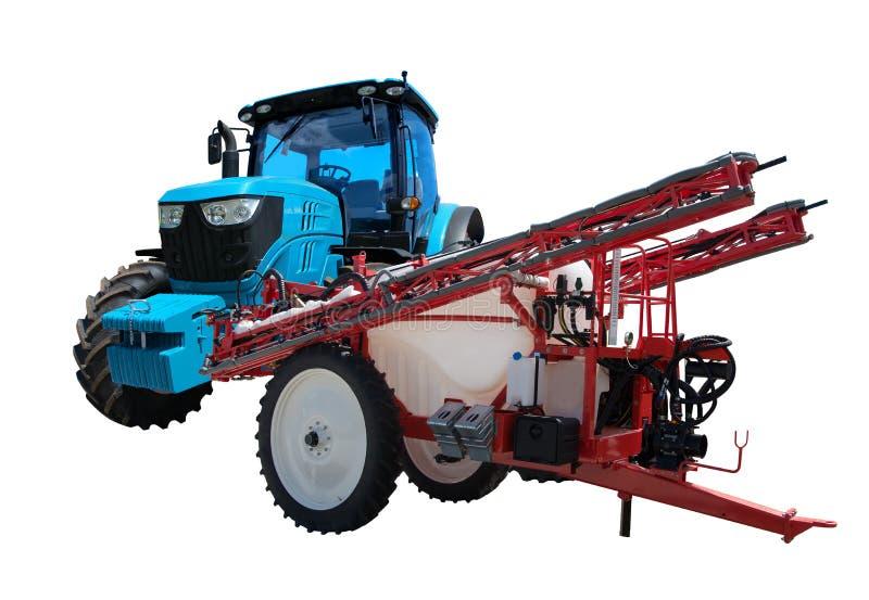 Den jordbruks- traktoren och traktoren skuggade sprejare arkivfoton