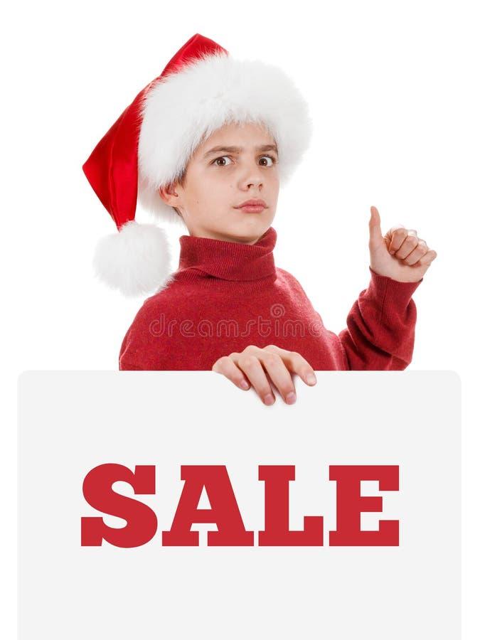 Den julsanta pojken visar den tomma affischtavlan arkivfoto