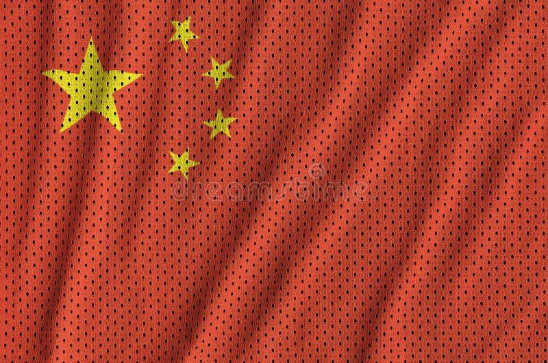Den Kina flaggan skrivev ut på ett tyg för ingrepp för polyesternylonsportswear w royaltyfri fotografi