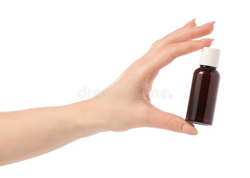 Den kosmetiska loppflaskan, dusch för hotellbadrumschampo stelnar lotion i hand arkivbild