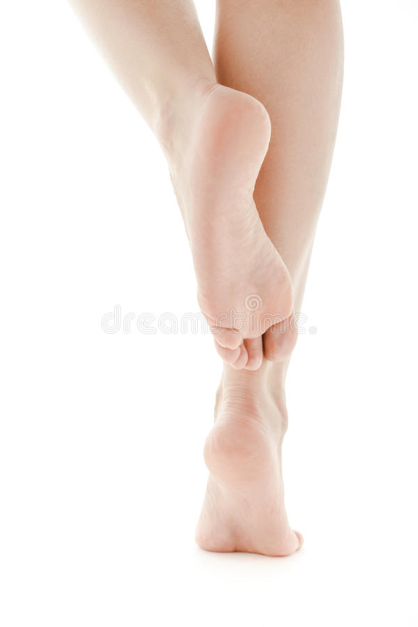 Den kvinnliga foten sular barfota vit isolerad bakgrund royaltyfri fotografi