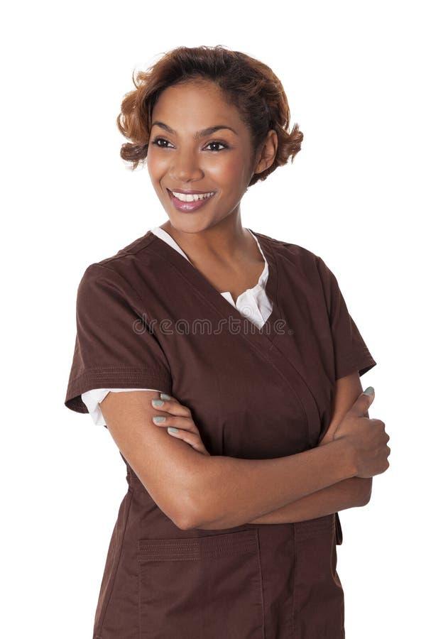 Den kvinnliga sjuksköterskan skurar in. arkivbilder