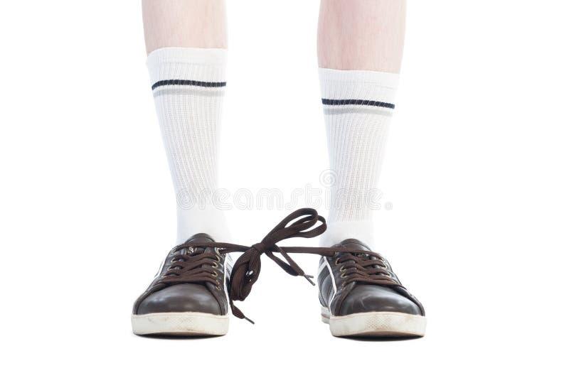 Den långa sockor och skon snör åt bundet tillsammans ofog arkivfoton